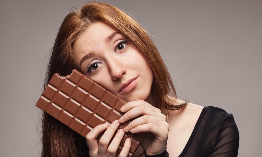 Sad young girl with the big chocolate