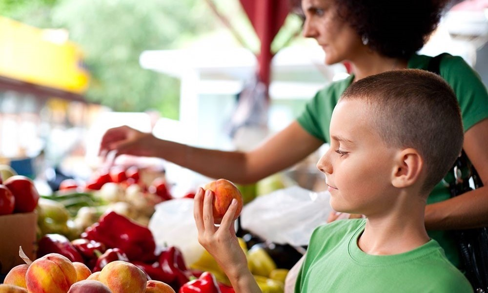 Son and mother, Organic Food Market