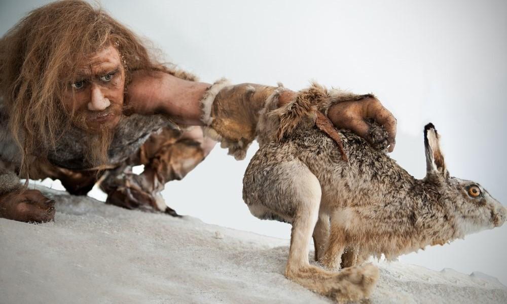 Caveman hunting for a rabbit